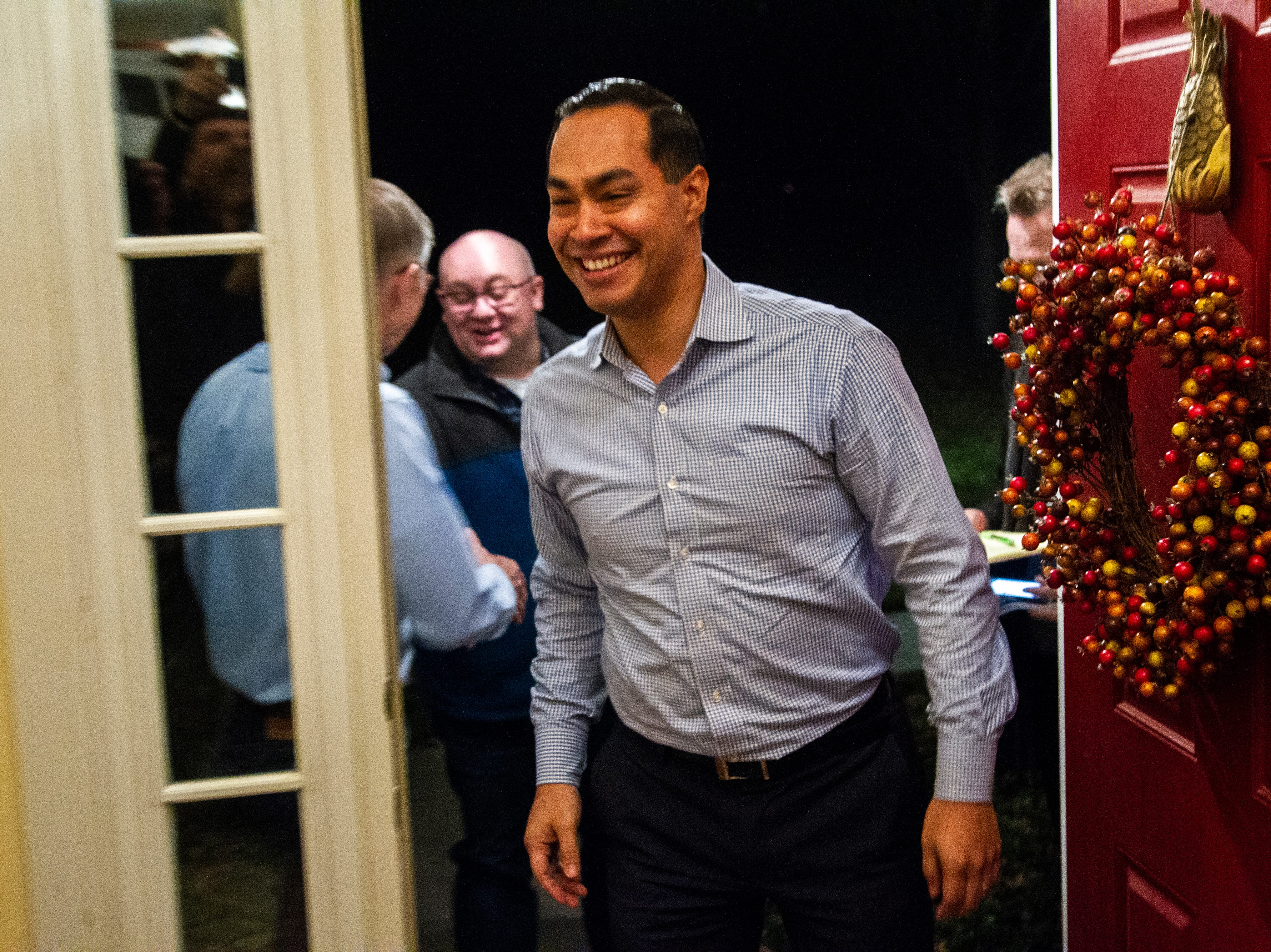 "Julián Castro is welcomed by supporters and local activists at the Johnson County ""Potluck Insurgency"" on Monday, Jan. 7, 2019, at a home in North Liberty, Iowa."