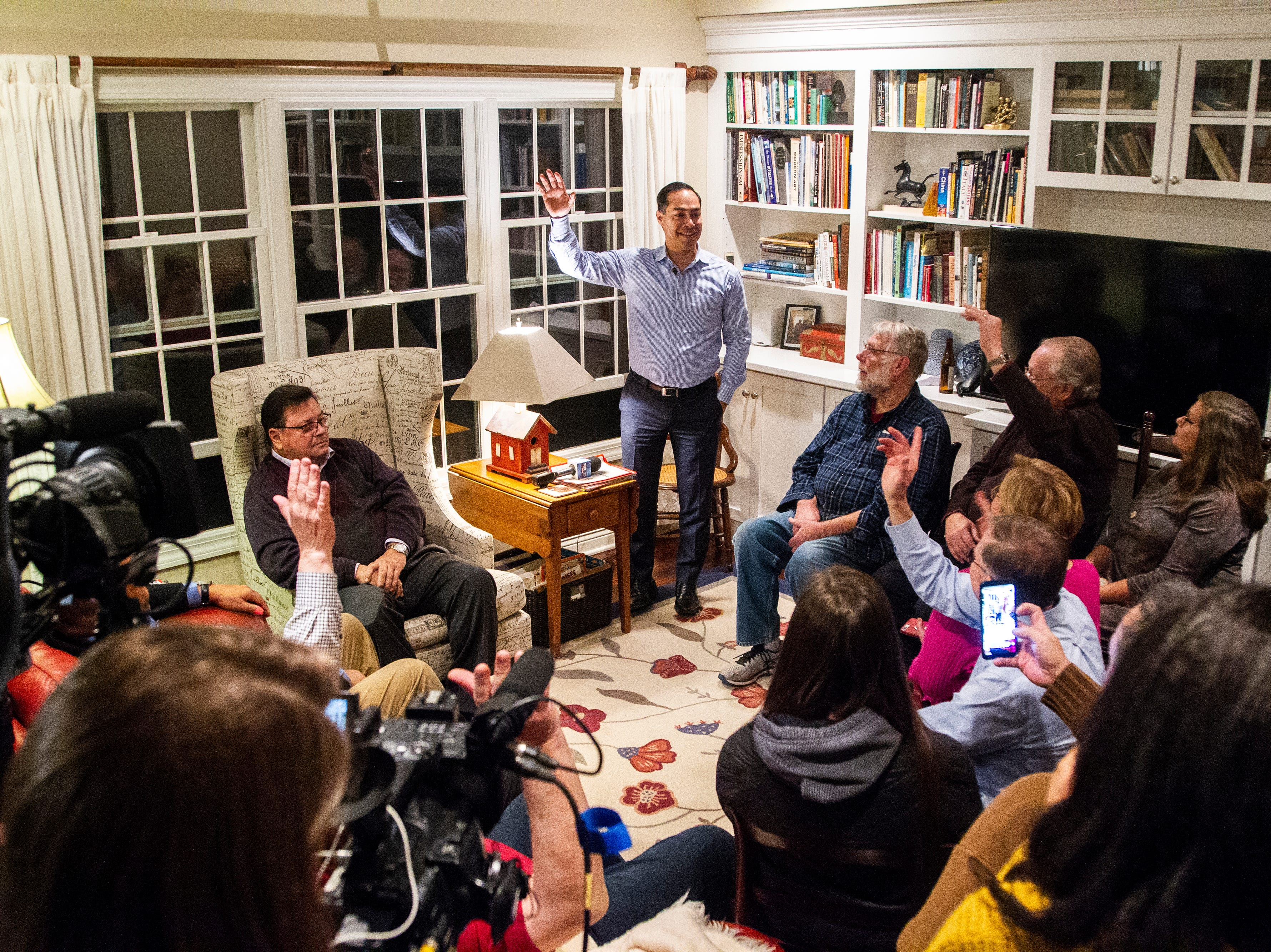 "Julián Castro speaks to supporters and local activists at the Johnson County ""Potluck Insurgency"" on Monday, Jan. 7, 2019, at a home in North Liberty, Iowa. Castro told supporters he will decide if he's going to run for president by Saturday."