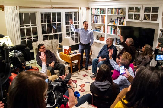 "Julián Castro speaks to supporters and local activists at the Johnson County ""Potluck Insurgency"" on Monday, Jan. 7, 2019, at a home in North Liberty, Iowa. Castro said he will decide if he's going to run for president by Saturday."