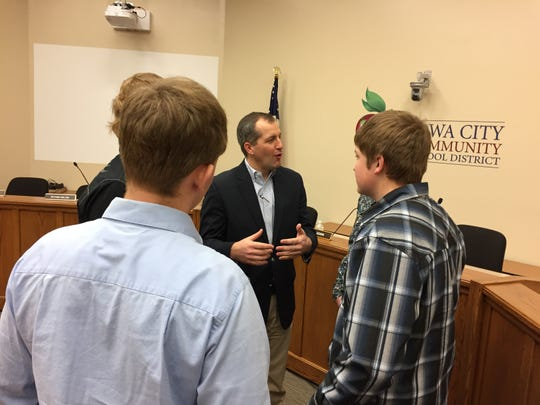 Iowa Secretary of Agriculture Mike Naig speaks with local students during a recent visit to Iowa City.