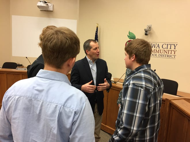 Iowa Secretary of Agriculture Mike Naig speaks with local students during a visit to Iowa City Tuesday.