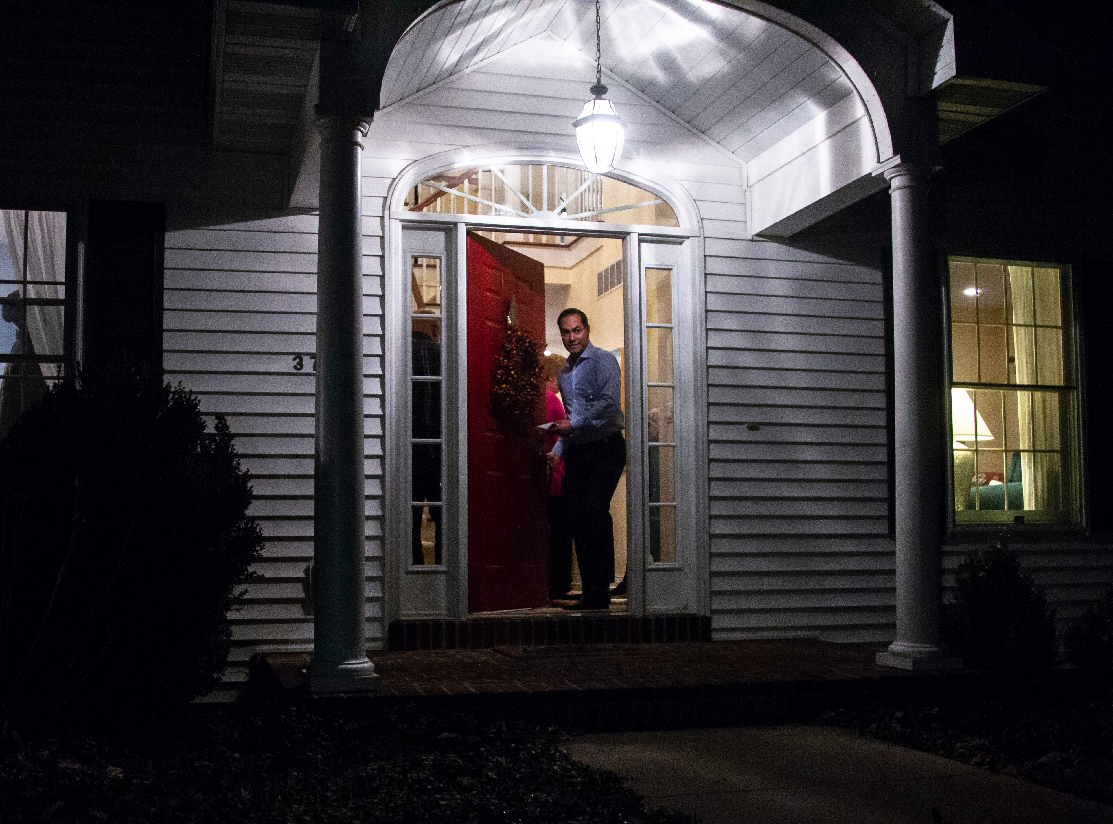 "Julián Castro opens the door on his way out after speaking at the Johnson County ""Potluck Insurgency"" on Monday, Jan. 7, 2019, at a home in North Liberty, Iowa."