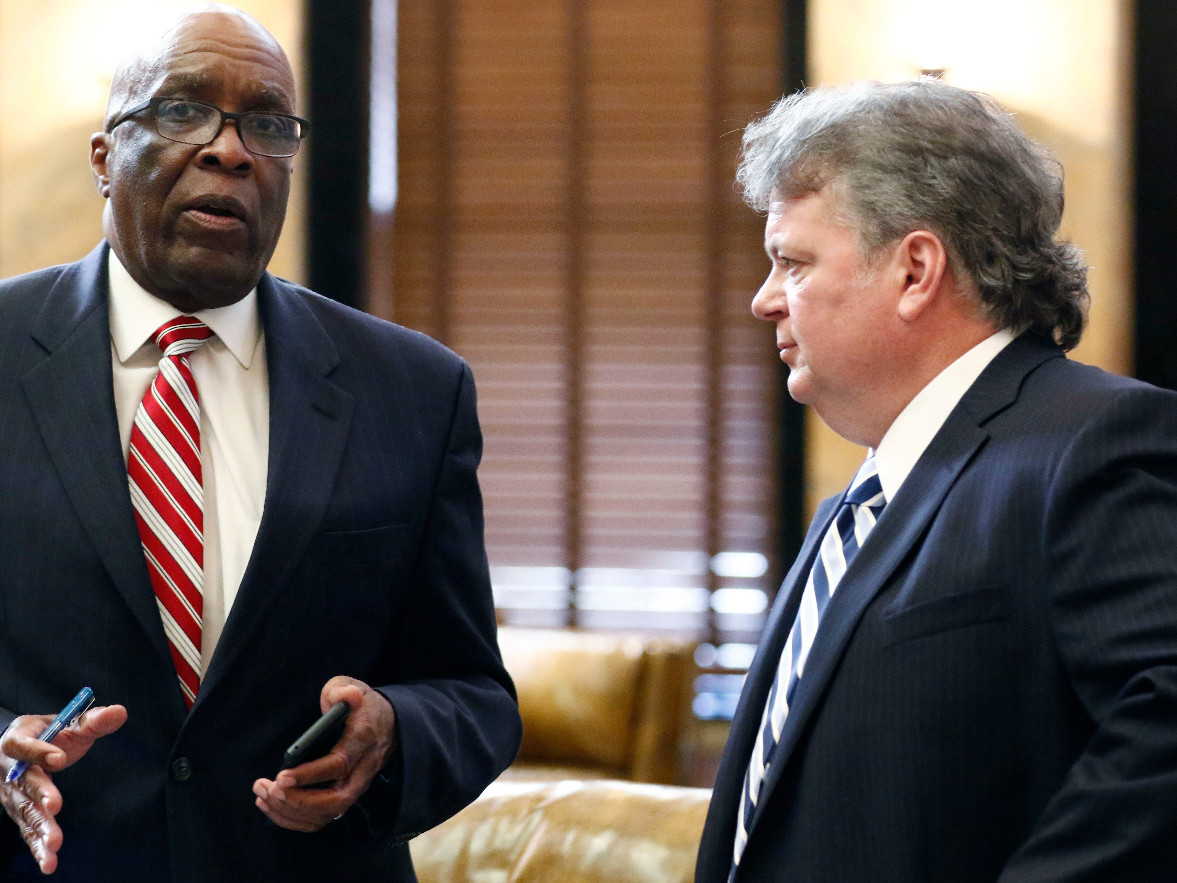 Attorney General Jim Hood, right, visits with Rep. Percy Watson, D-Hattiesburg, in House chambers following the adjournment of the first day of the 2019 Mississippi legislative session at the Capitol in Jackson, Miss., Tuesday, Jan. 8, 2019. Hood, a Democrat, is an announced candidate for governor, and visited with a number of lawmakers as he introduced them to his agency's new legislative liaison.