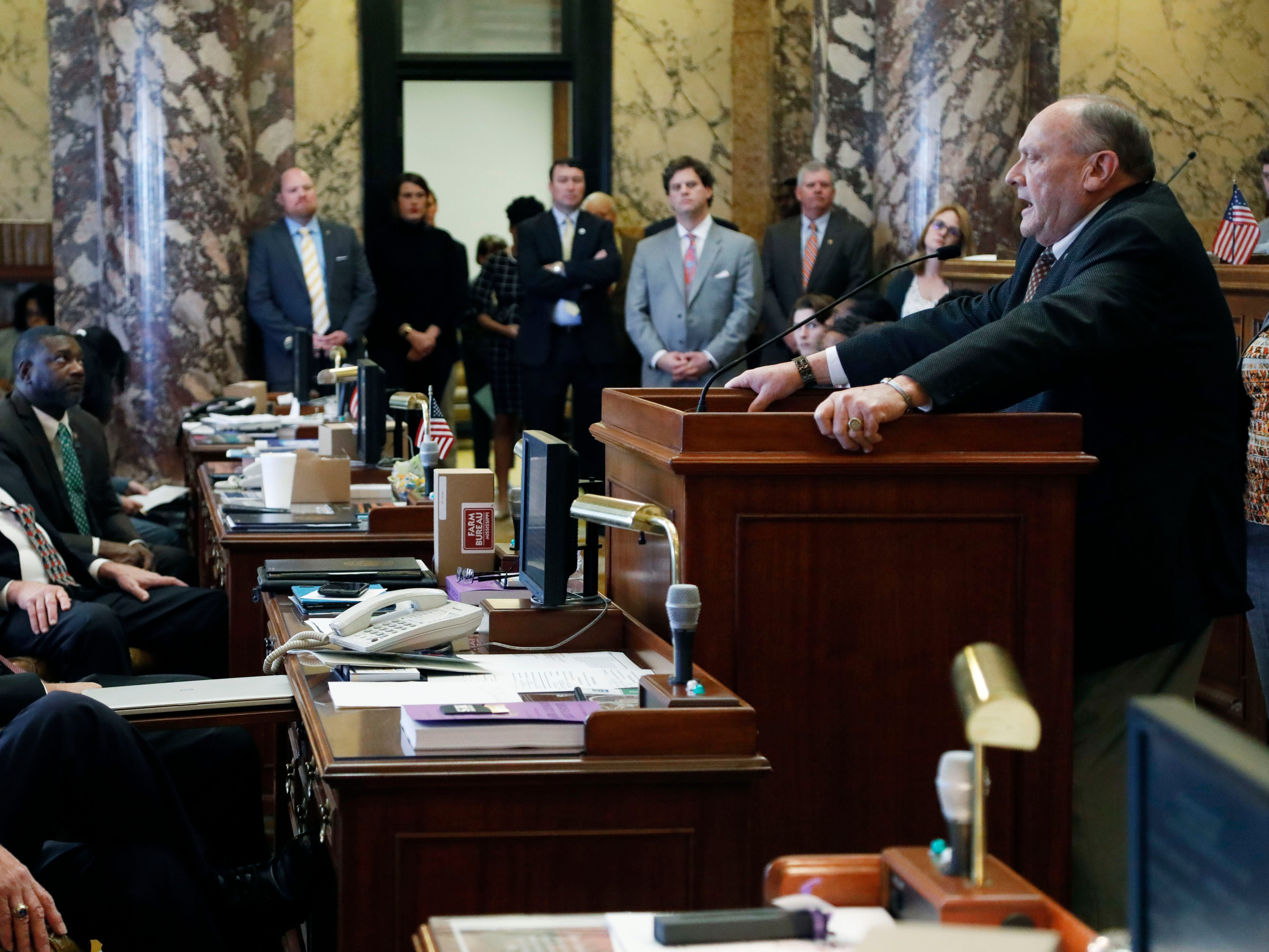 Republican Terry Burton of Newton, president pro tempore of the Mississippi Senate, tells the body he is resigning his leadership role, weeks after being charged with second-offense drunken driving, moments after the beginning of the 2019 legislative session at the Capitol in Jackson, Miss., Tuesday, Jan. 8, 2019. Burton says he will remain in the 52-member Senate this year but will not seek another four-year term in office.