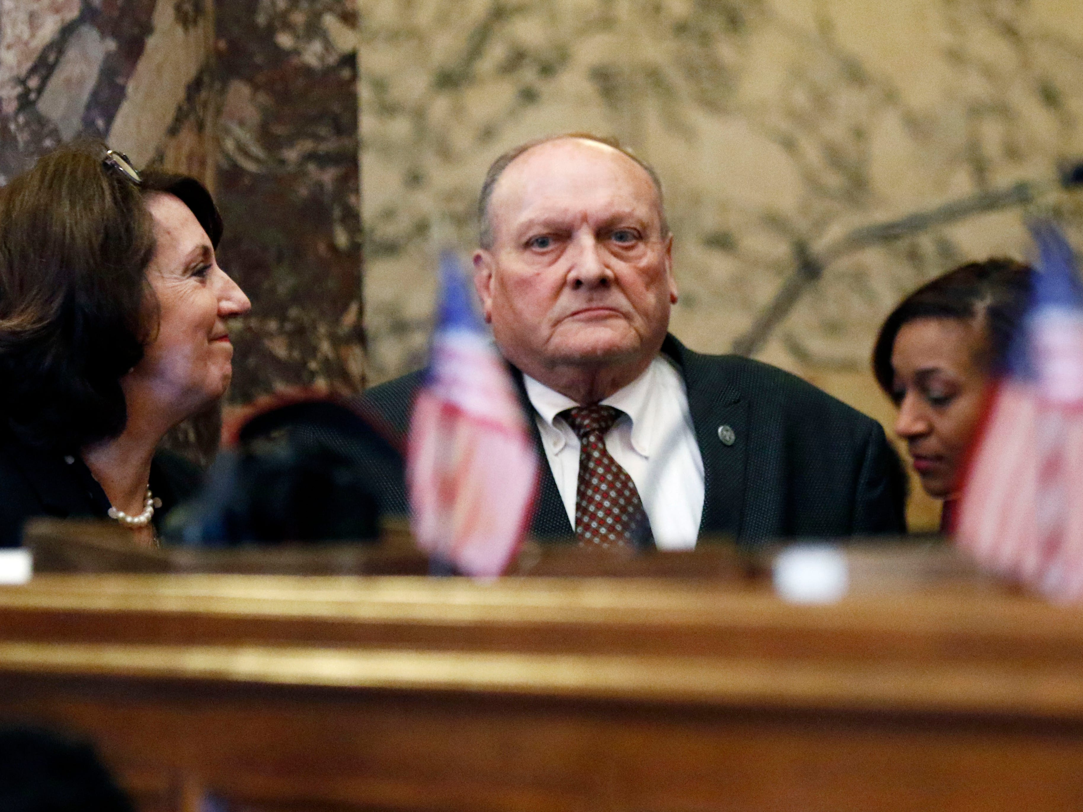 Republican Terry Burton of Newton, president pro tempore of the Mississippi Senate, listens as officials and senate staff applaud him after telling the body he is resigning his leadership role, weeks after being charged with second-offense drunken driving, moments after the beginning of the 2019 legislative session at the Capitol in Jackson, Miss., Tuesday, Jan. 8, 2019. Burton says he will remain in the 52-member Senate this year but will not seek another four-year term in office.