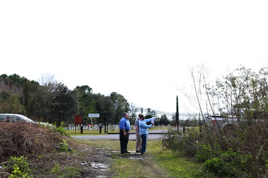 FBI agent Joseph Bignell and Pascagoula police Lt. Darren Versiga view a wooded site on Greenwich Road in Moss Point on January 7, 2019. A woman's body was found in washout near a telephone pole decades ago and investigators believe she was a victim of serial killer Samuel Little. Little admitted to killing a Jackson woman in Pascagoula.