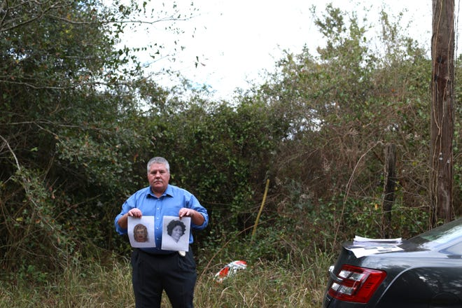 Pascagoula police Lt. Darren Versiga stands with two composite images off Greenwich Road in Moss Point on January 7, 2019. The police image, right, is a woman who was dumped in a washout near a telephone pole on the street decades ago. Investigators believe the the woman, who has not been identified, was killed by serial killer Samuel Little. Little drew a photo of the woman he killed (left). Little acknowledged the composite sketch was likely the victim, who he said was from the Jackson area.