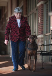 Rebecca Floyd, executive director of Gallant Hearts Guide Dog Center in Madison, is steered clear of obstacles and dangers by May, her five-year-old Doberman pinscher. Gallant Hearts is different than other guide dog organizations in that it takes the dog to the person in need, training the canine companion where it will live and work. The Gallant Hearts trainer stays with them seven to ten days.