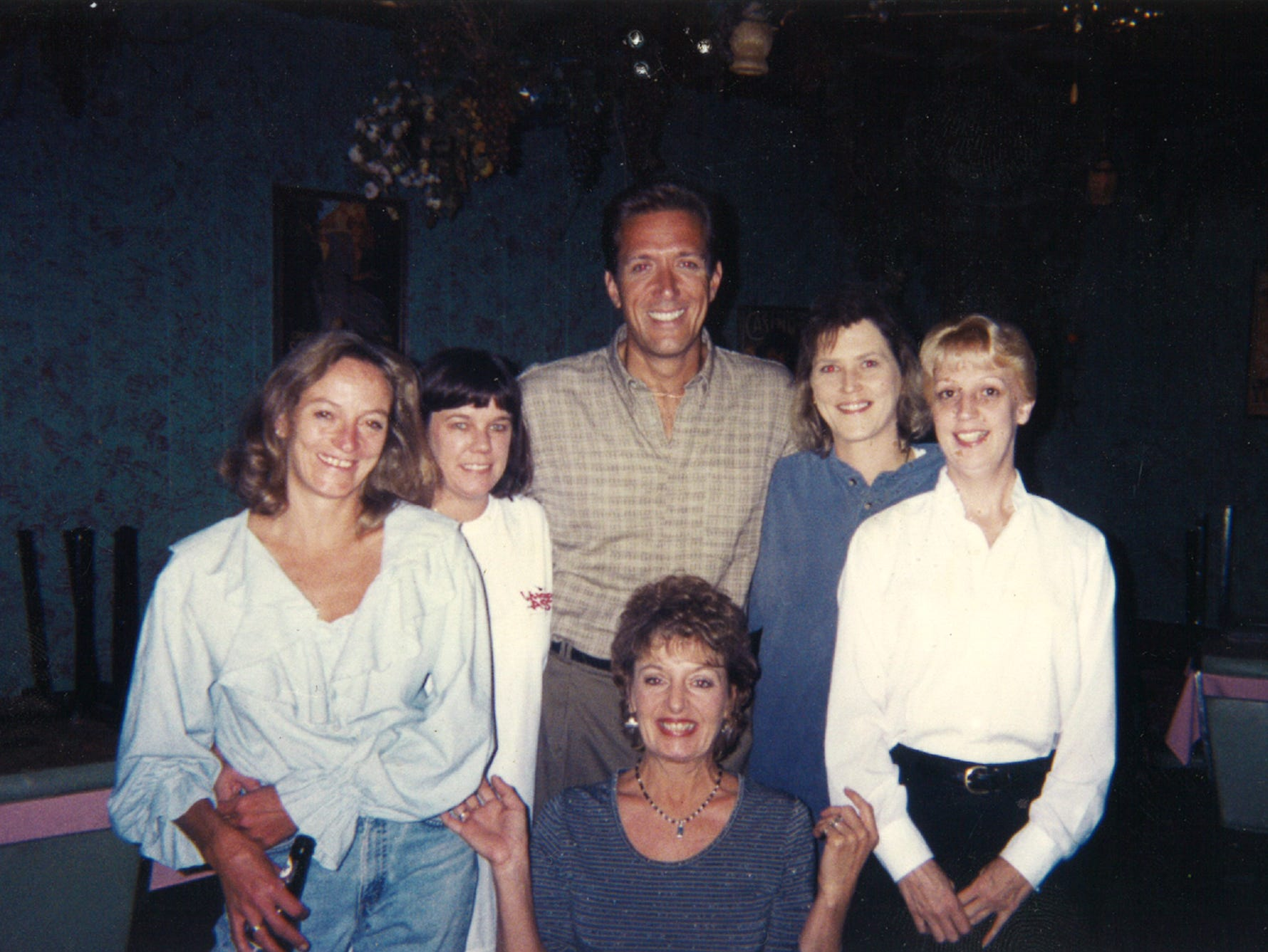 """Jackson Montgomery, a star from TV show """"All My Children,"""" stands among a group of women working at Baudo's Restaurant in Jackson, Tenn. Current owner Sharon Baudo Smith said a few famous faces have appeared at the restaurant over the years, including Garth Brooks."""