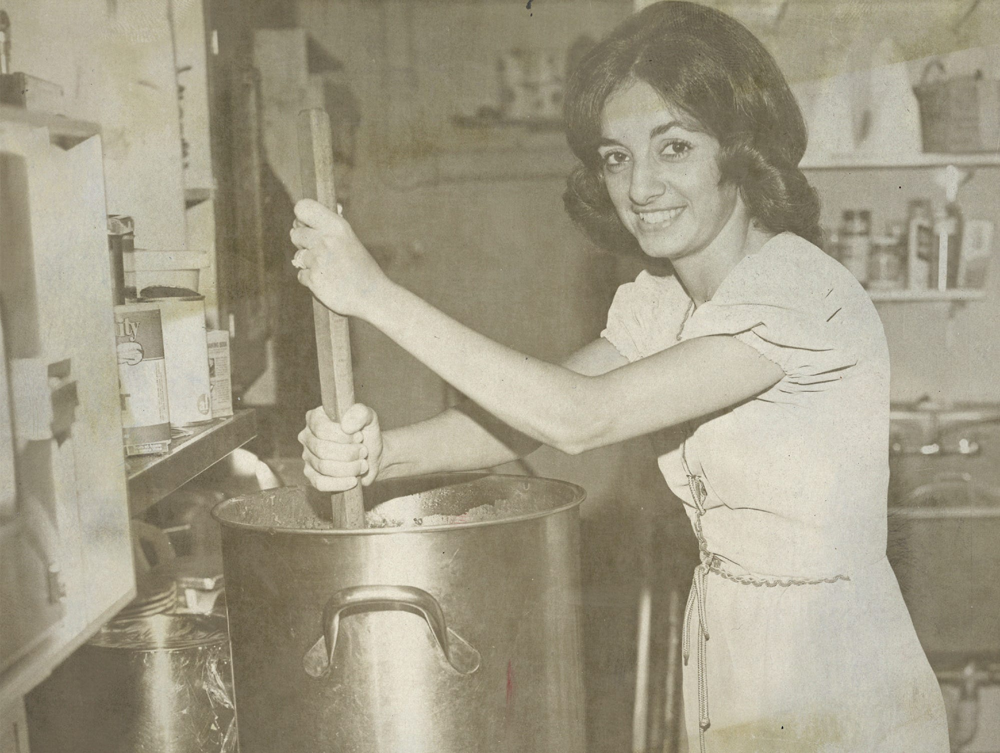 Sharon Baudo Smith stirs a pot in Baudo's Restaurant in Jackson, Tenn. The restaurant still makes their own sauces and dressings using the same recipes, Smith said.