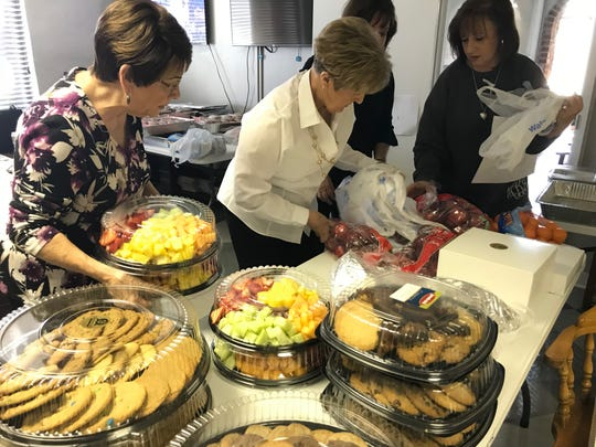 Blue Strong Committee members Jamie Joyner, Emily Crabtree, Tammy Buchanan and Committee Chair Mary Jo Bell process food donations for National Law Enforcement Day deliveries in Jackson, Tenn.
