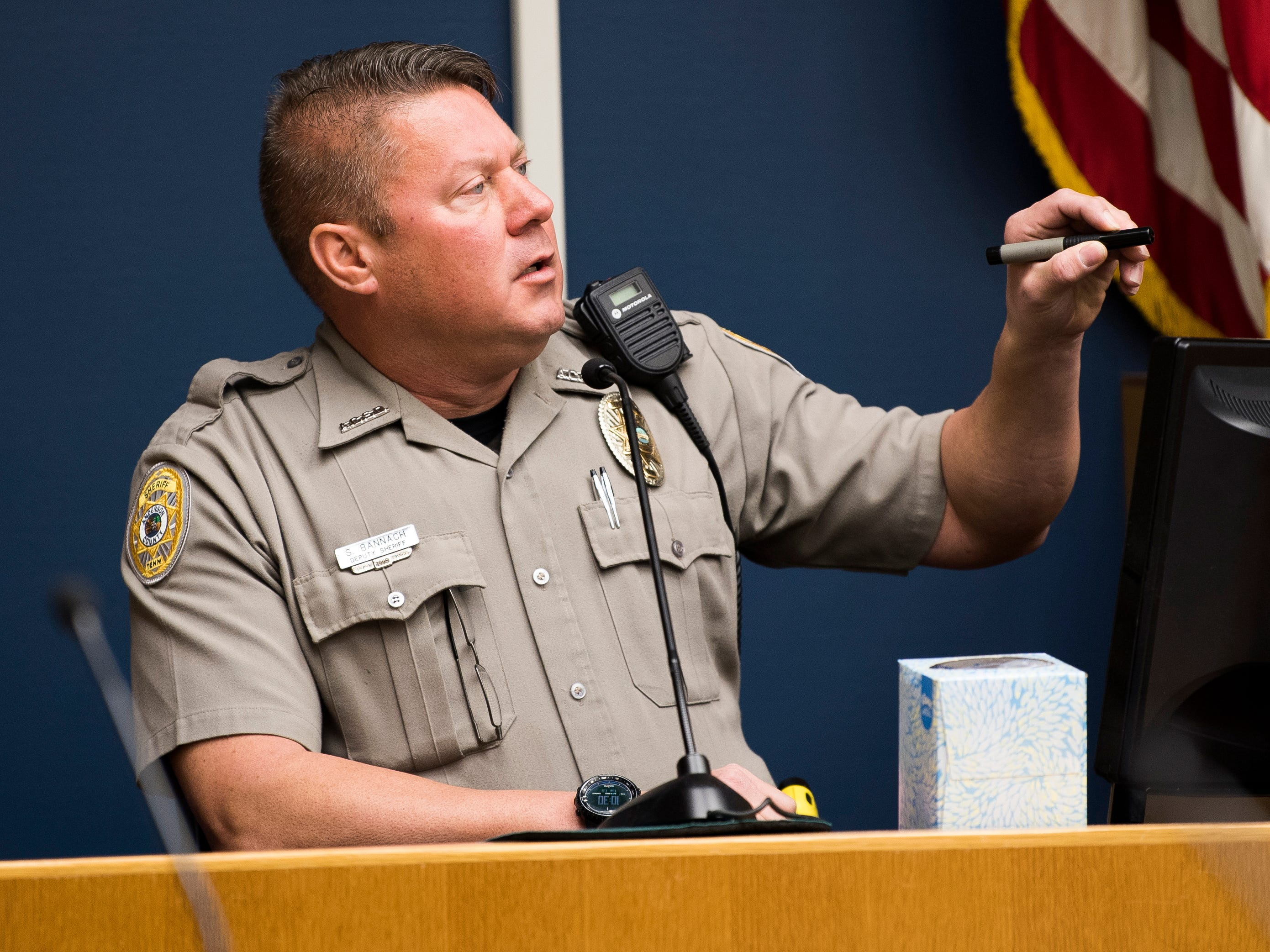 Anderson County Sheriff's Office Deputy Shawn Bannach uses a laser pointer to point out locations on a map during Rapheal Coffey's trial in Knox County Criminal Court on Tuesday, January 8, 2019.