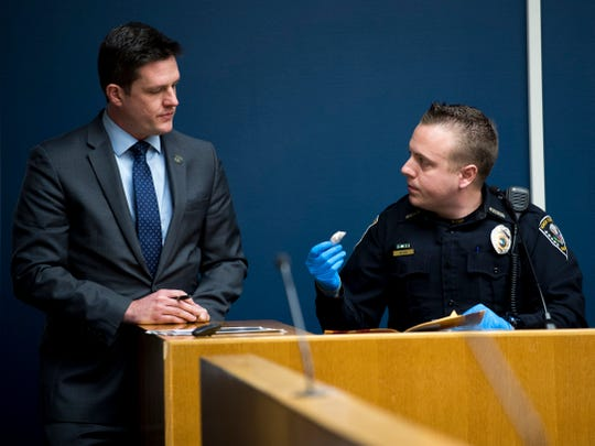Knox County Sheriff's Office Deputy Andy Wilson, right, shows Knox County Deputy District Attorney Kyle Hixson drugs recovered at the scene during Rapheal Coffey's trial in Knox County Criminal Court on Tuesday, January 8, 2019.