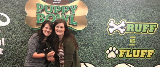 YWAC Marketing Manager Courtney Kliman and YWAC Visuals Coordinator Hannah Overton pose with Knoxville puppy Molly Mae during the taping of Animal Planet's 2019 Puppy Bowl in New York City. It will air Feb. 3.