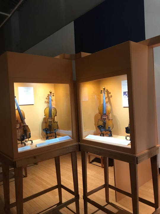 These three violins owned by Jewish musicians during the Holocaust are on exhibit at the University of Tennessee Downtown Gallery.