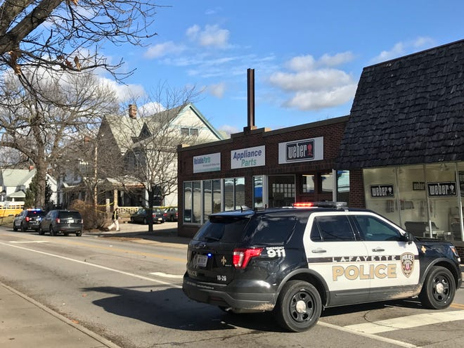 Lafayette police closed North Ninth Street late Tuesday morning after a report that an officer had been shot during an investigation between Salem and Union streets.