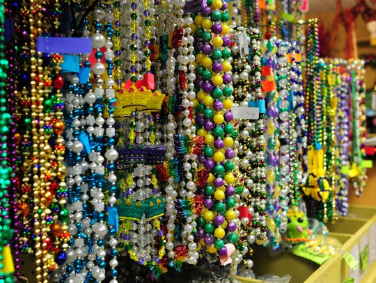 Multiple varieties of Mardi Gras beads are displayed on the walls of Beads Galore in Lafayette, Louisiana, on Feb. 5, 2014.