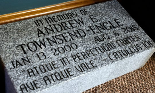 A memorial stone for Andrew Townsend-Engle sits in the cemetery department office at Forest Rose Cemetery in Lancaster. Friends of Townsend-Engle raised money to help establish a scattering garden for cremated remains.