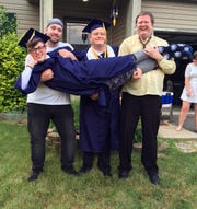 Drew Townsend-Engle is held by Scott Lee, Marcus Mullins and Kevin Mullins. Townsend-Engle's friends including Marcus Mullins are using donations collected after Townsend-Engle committed suicide last year to establish a scattering garden at Forest Rose Cemetery in Lancaster and create a scholarship to Lancaster High School students and provide money for suicide prevention at the school.