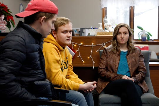 Marcus Mullins, center, talks with Bradley Snyder, left, and Hope Rooker Thursday, Dec. 27, 2018, at the Lancaster Cemetery department office at Forest Rose Cemetery in Lancaster. Mullins, Snyder, Rooker and other friends of Andrew Townsend-Engle have donated money raised after Townsend-Engle committed suicide this summer to create a remembrance and scattering garden at the cemetery in their friend's memory. They're also establishing a scholarship for Lancaster High School Choir students and donating money for suicide prevention education at the high school.