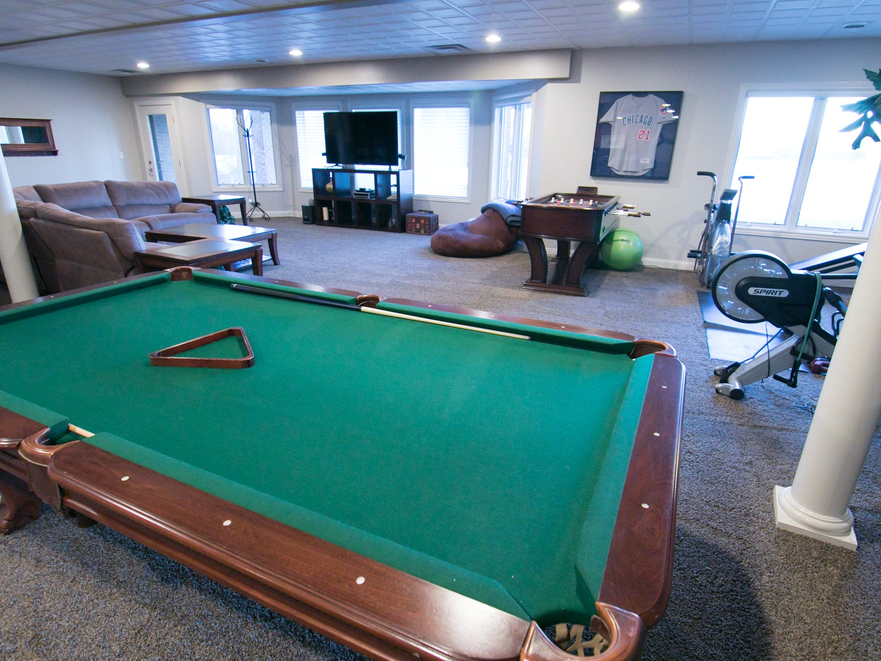 The basement of Adam and Michelle Harris's Genoa Township home, shown Friday, Jan. 4, 2019, is a prime gathering space for the Harrises' children to hang out and entertain friends.