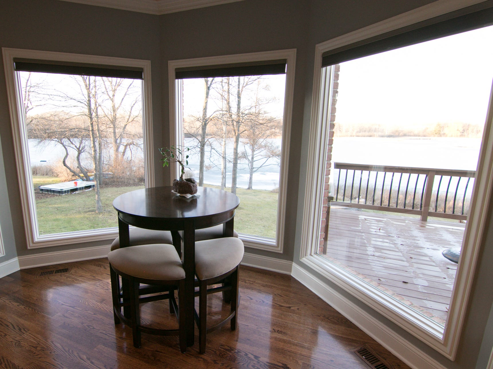 Windows throughout the home owned by Michelle and Adam Harris, shown Friday, Jan. 4, 2019, provide spectacular views of Worden Lake in Genoa Township.