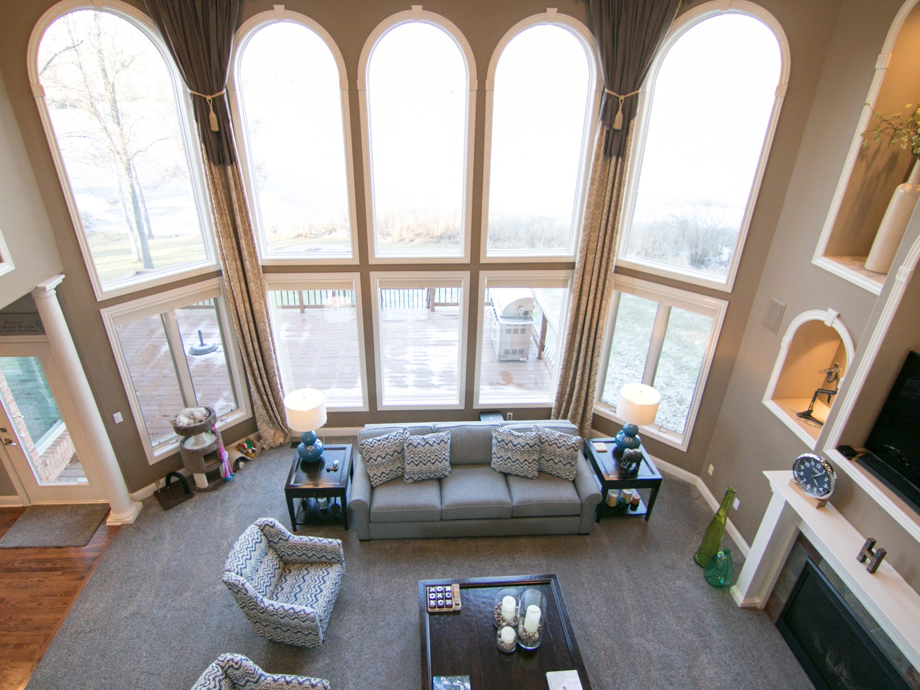 Floor-to-extra high ceiling windows in the living room provide a great view of Worden Lake as well as plentiful lighting in the Harris home, shown Friday, Jan. 4, 2019.