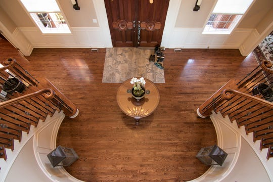 A grand stairway greets visitors to the Harris home on Aljoann Road in Genoa Township, shown Friday, Jan. 4, 2019.