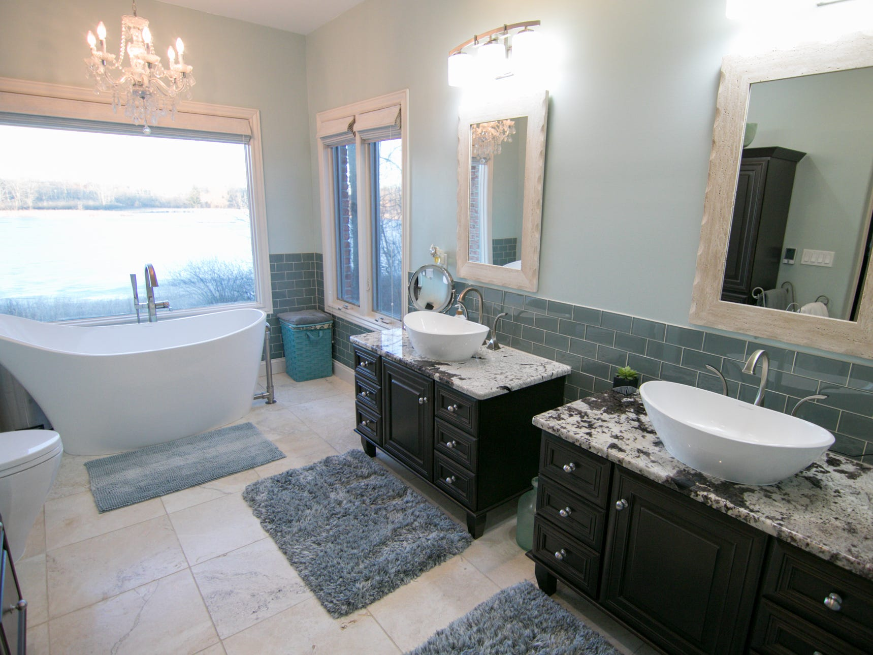 Custom vanities and a slipper tub are among the niceties of the master bath in Michelle and Adam Harris's home, shown Friday, Jan. 4, 2019.