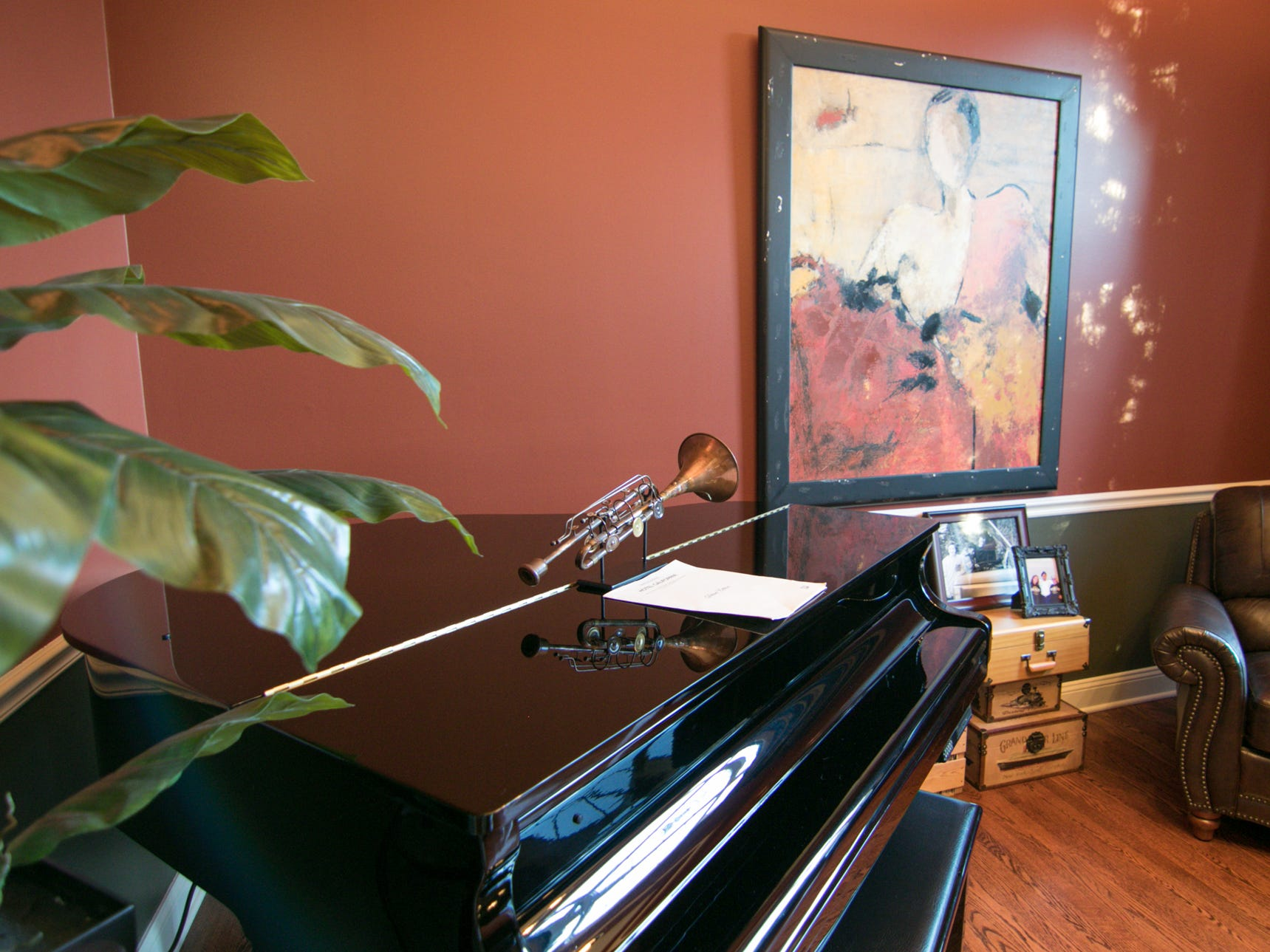 A sitting room in the Harris home shown Friday, Jan. 4, 2019 has a player piano.