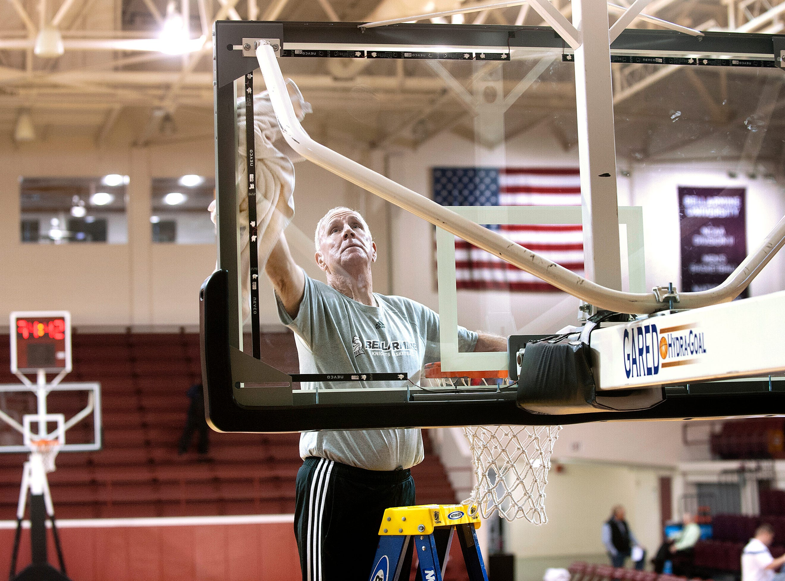 Each day before a game, Bellarmine head basketball coach Scott Davenport, now  in his 14th season of coaching at Bellarmine,  pulls out a stepladder and cleans the backboards in Knights Hall. 18December 2018