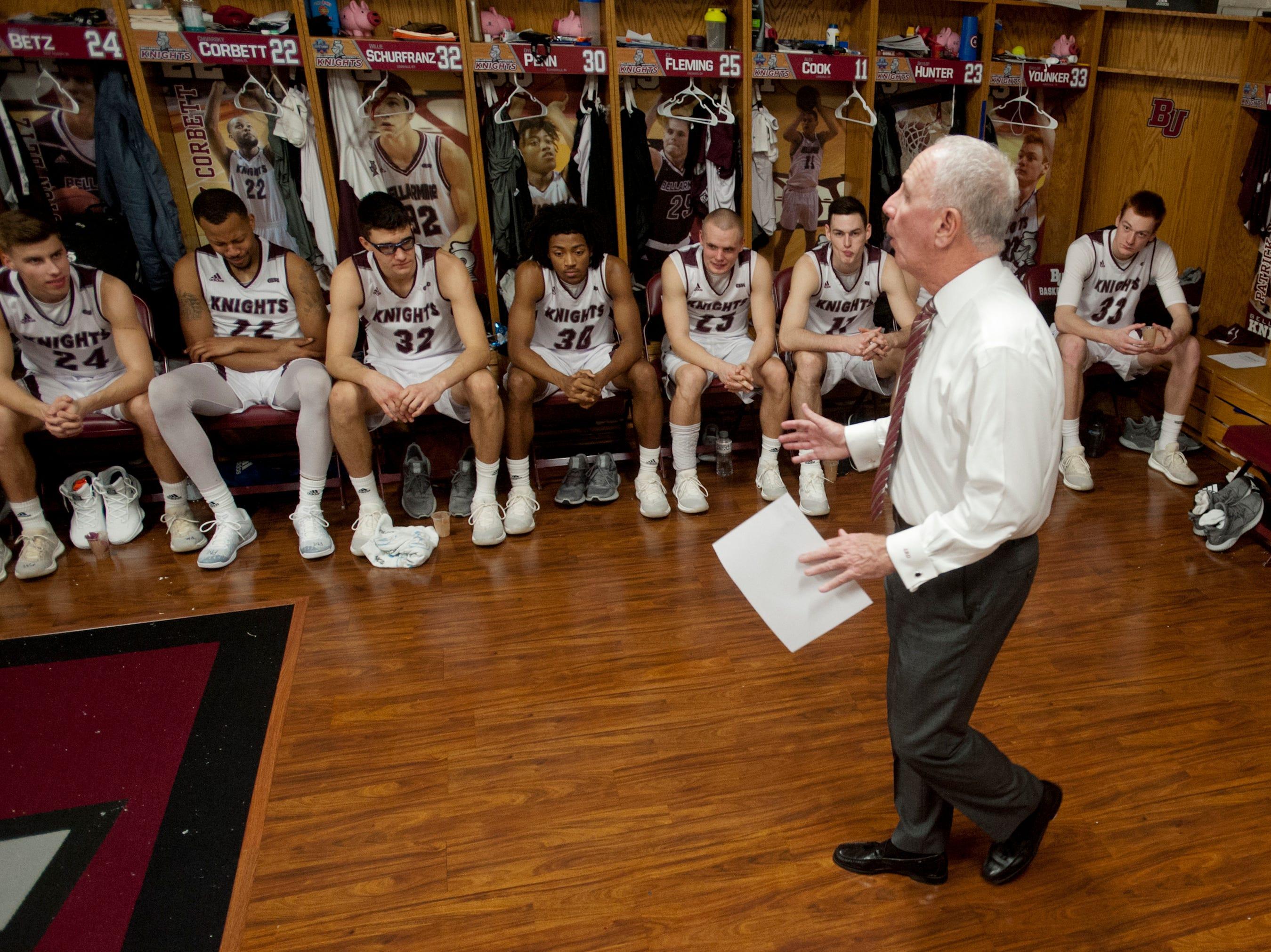 Bellarmine head basketball coach Scott Davenport reviews his team's game performance in the locker room.18 December 2018
