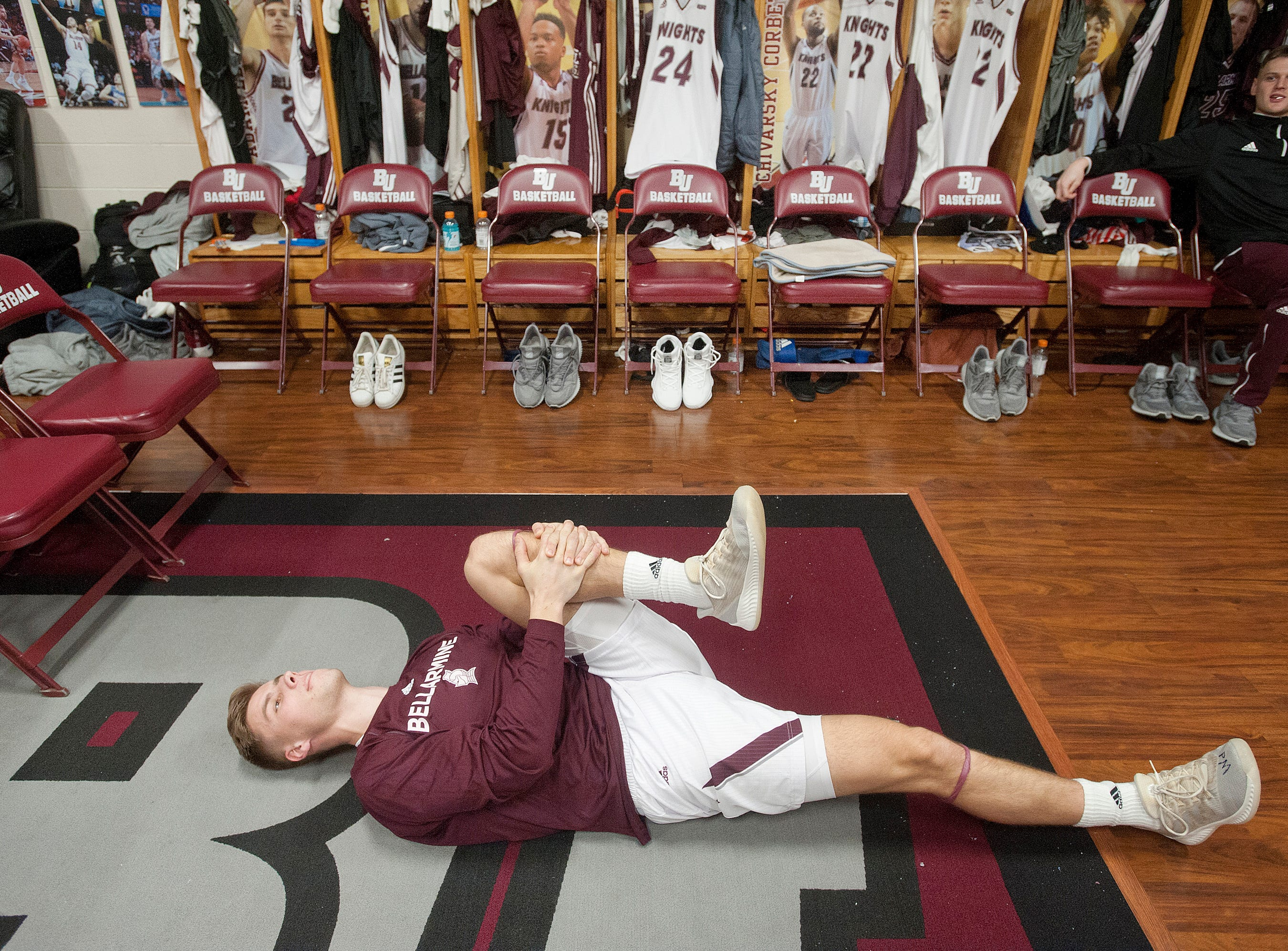 Bellarmine guard Juston Betz  stretches just before the start of the game.18 December 2018