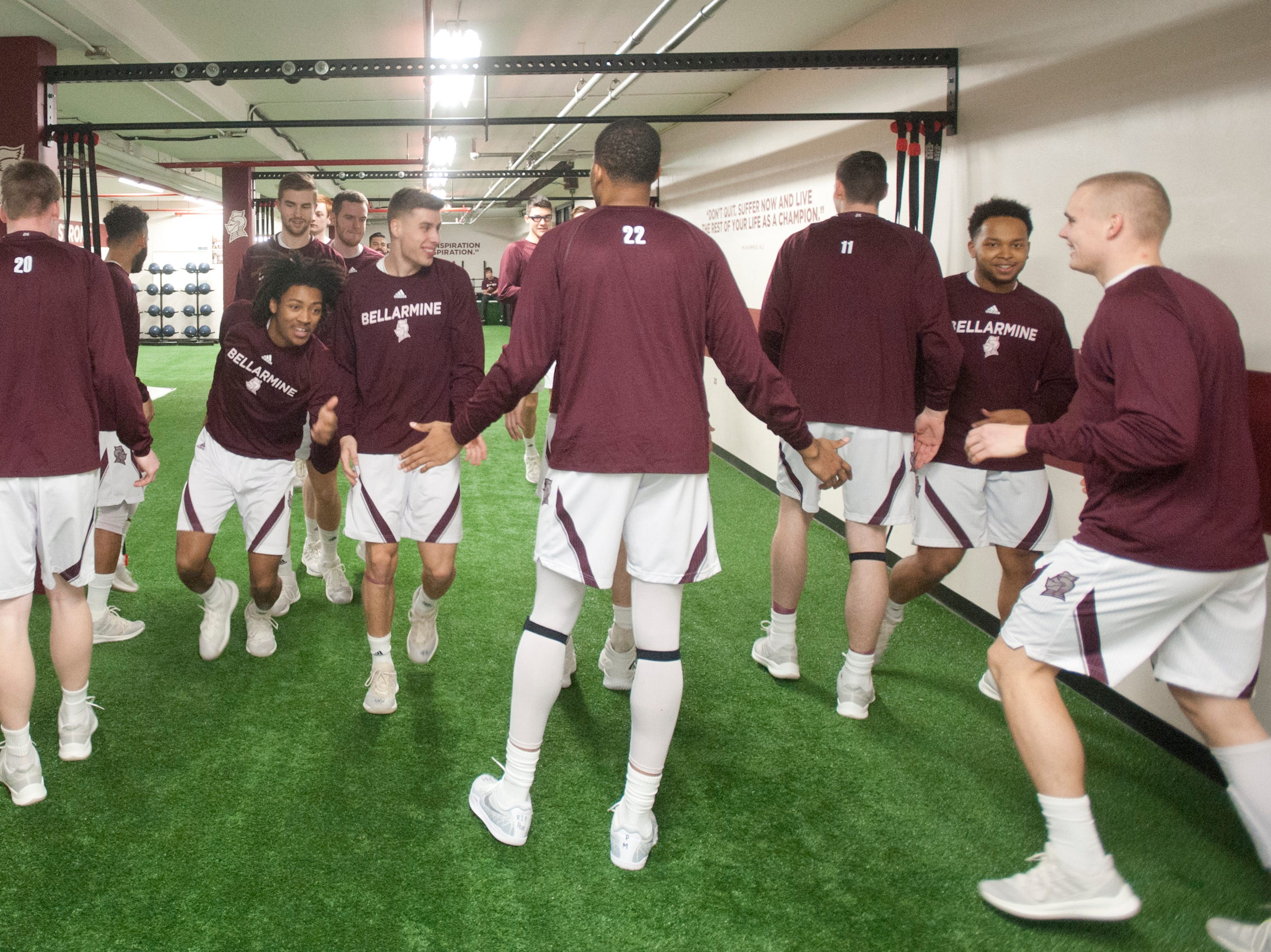 As Bellarmine player exercise their way up and down the training room, they slap each other's hands for each successful trip.18 December 2018