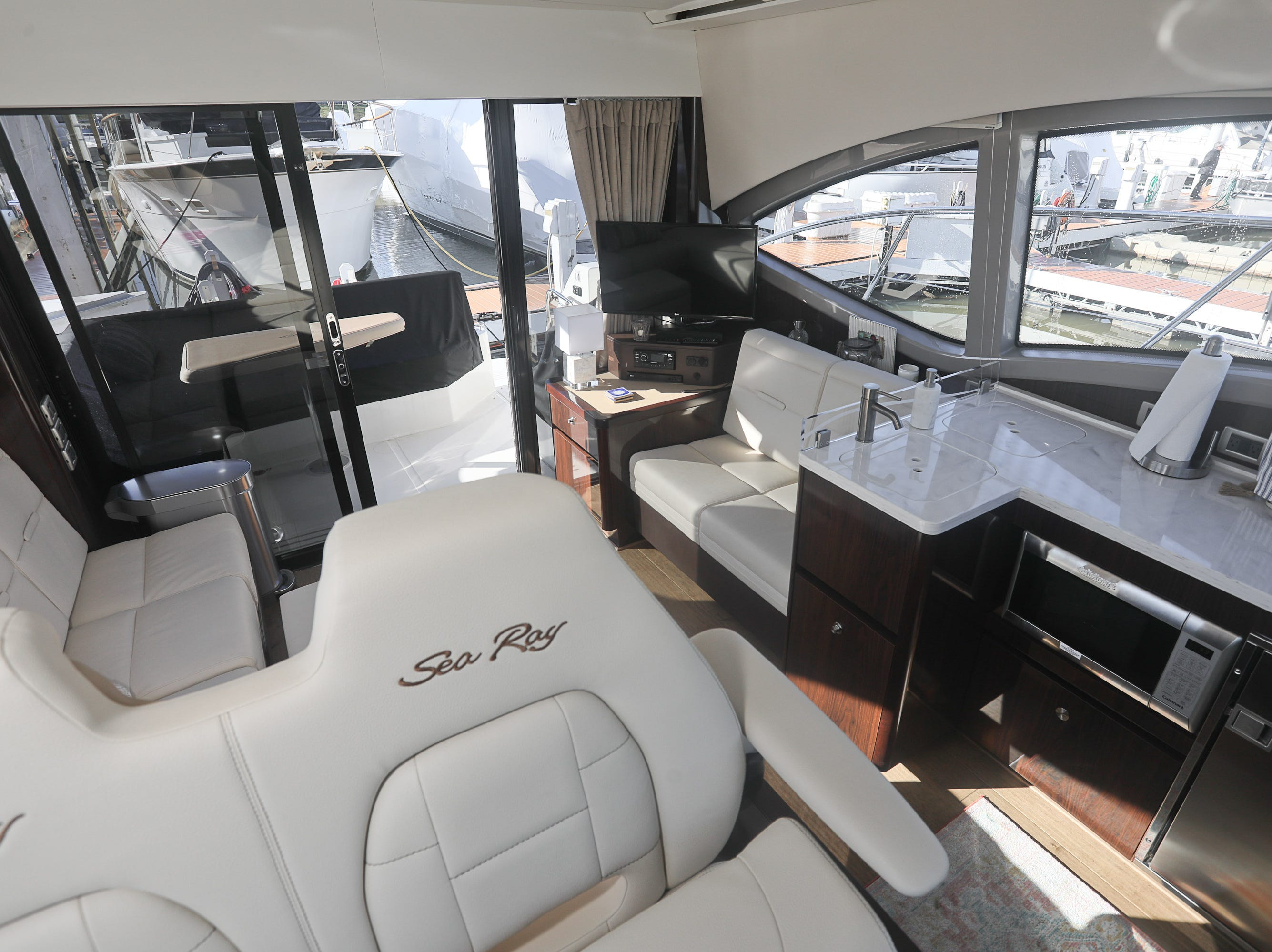 The saloon and galley of a 2017 Sea Ray 400 Sundancer at the Captain's Quarters marina in Louisville, KY. Dec. 17, 2018