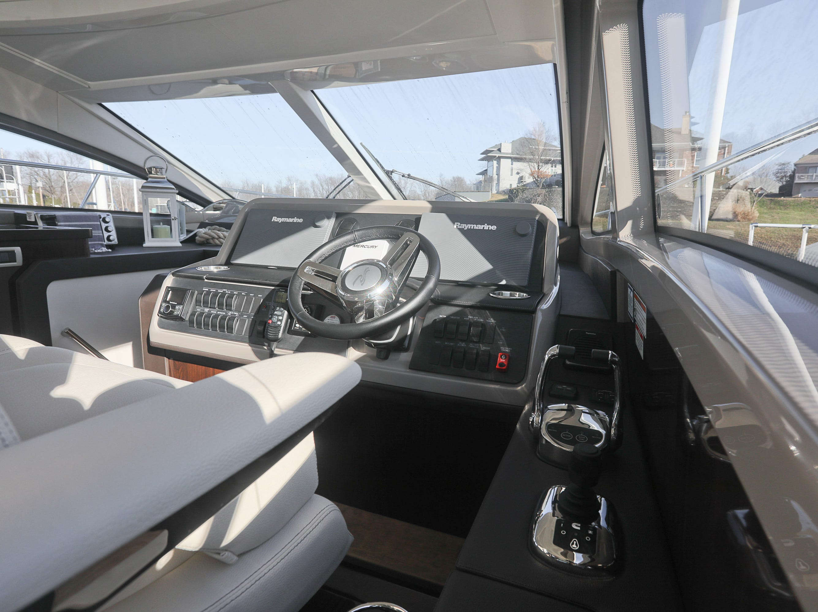 The helm of a 2017 Sea Ray 400 Sundancer at the Captain's Quarters marina in Louisville, KY. Dec. 17, 2018