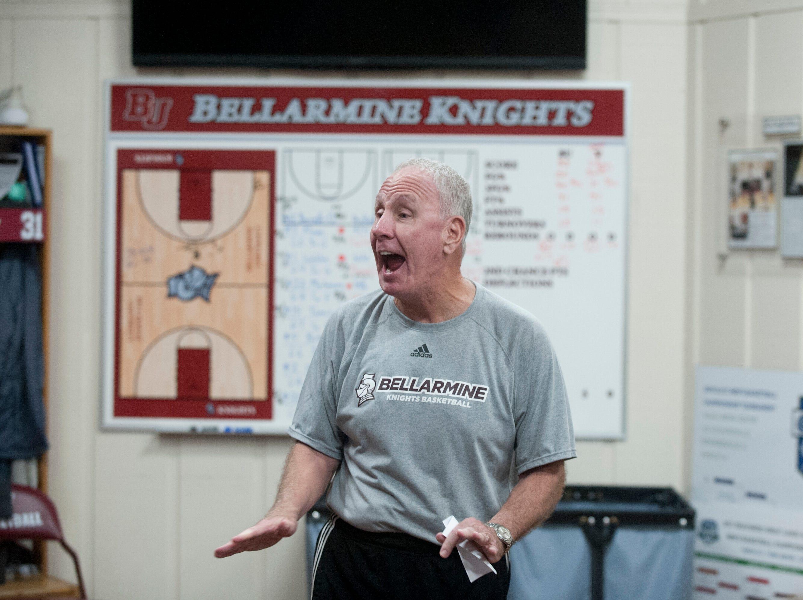 Bellarmine head basketball coach Scott Davenport speaks during an after-practice meeting with his team in their locker room.18 December 2018