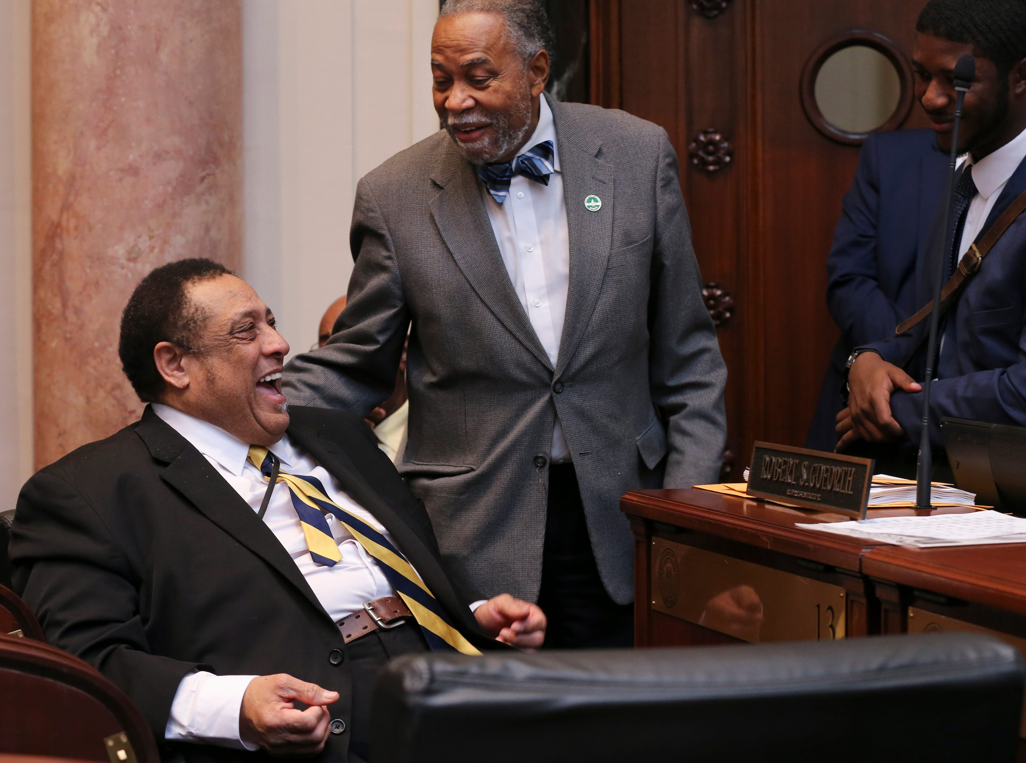Sen. Gerald Neal, center, came over to the House to congratulate Rep. Jim Glenn, left, who was elected to the House seat for Owensboro by one vote.  The the disputed House seat is being investigated by a committee formed by the House.Jan. 8, 2019