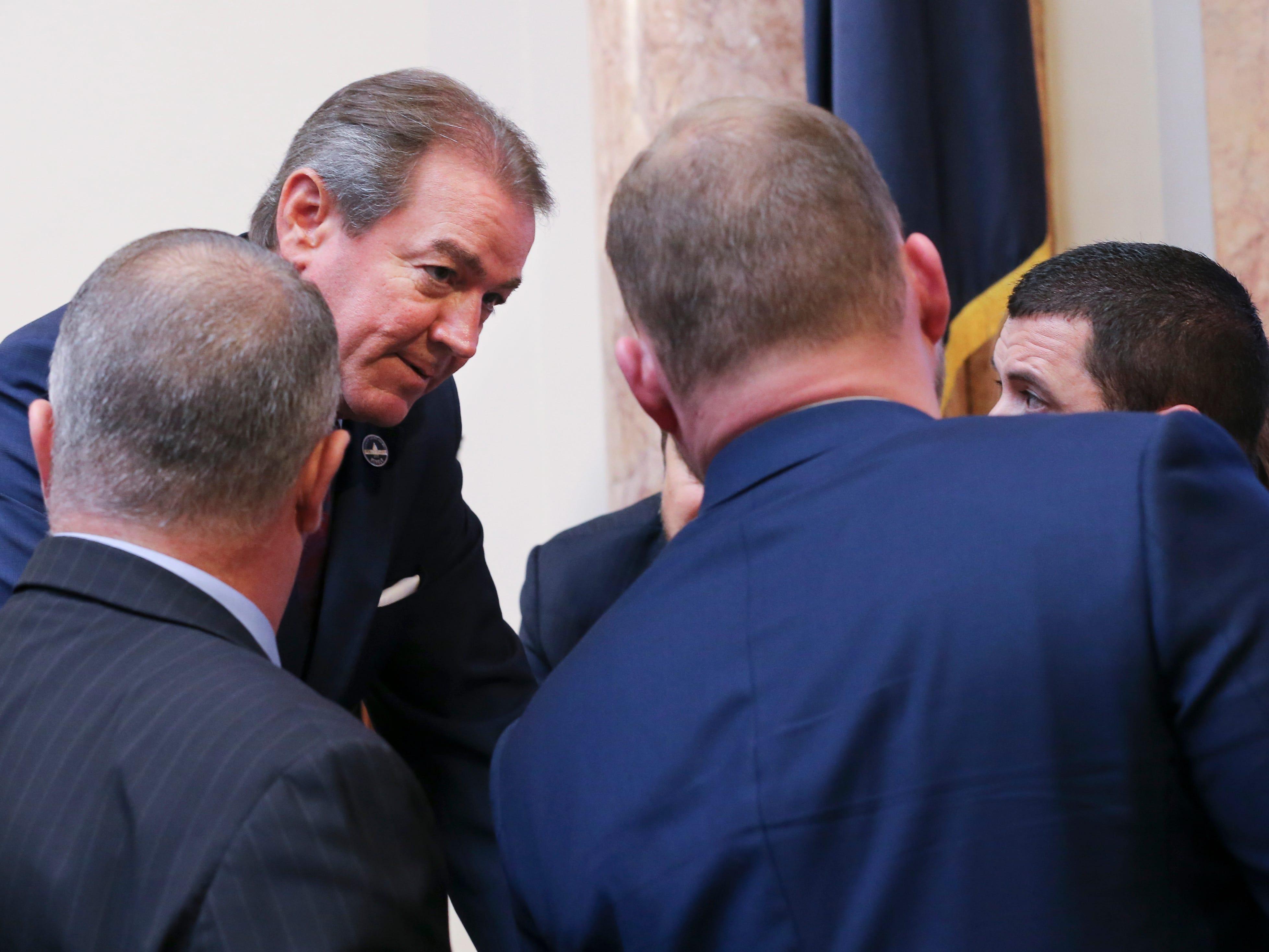 House Speaker David Osborne huddled with members before a committee was formed to investigate the disputed House seat for Jim Glenn who was elected to the House seat for Owensboro by one vote.  Jan. 8, 2019