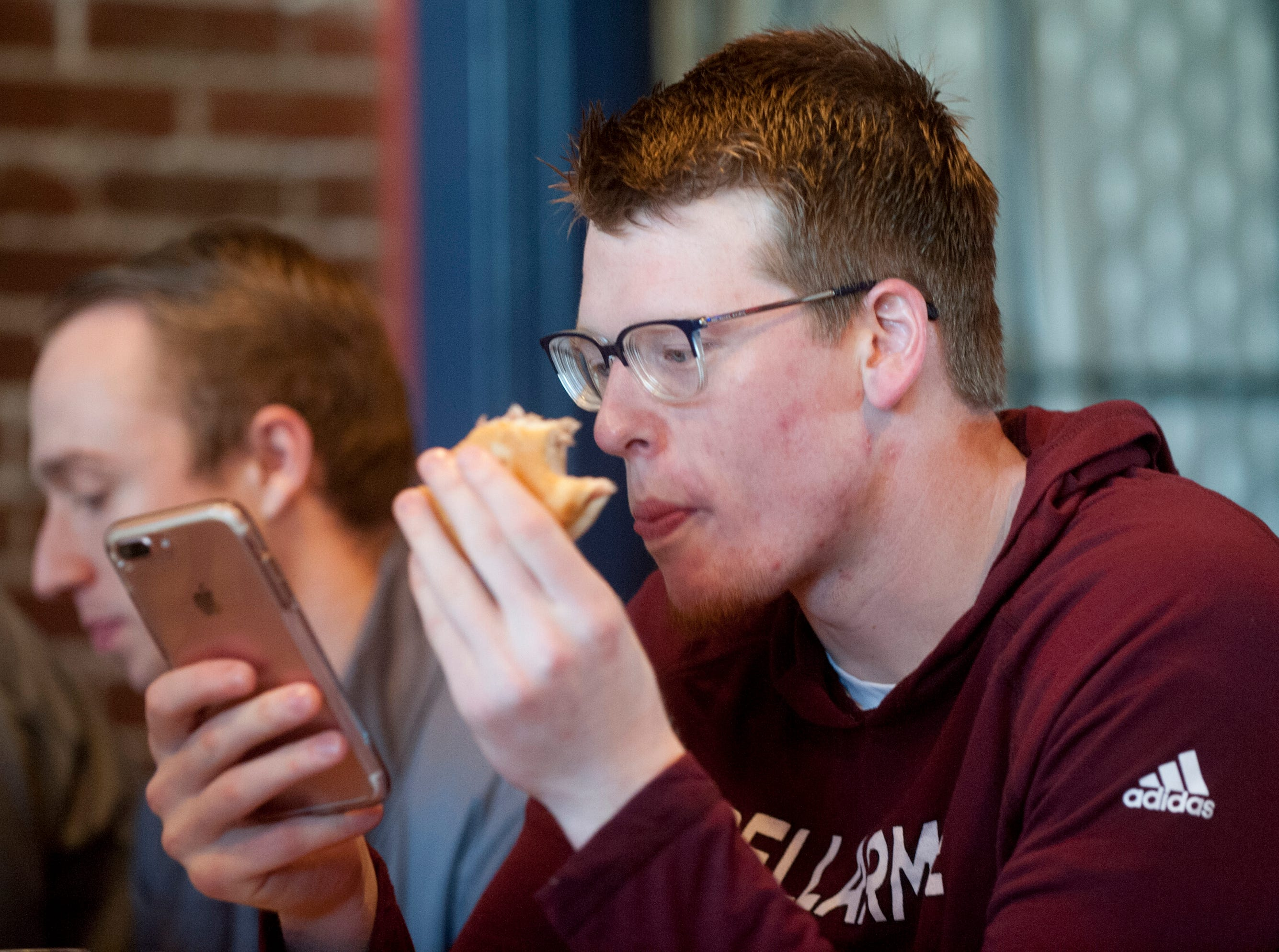 During the team's afternoon meal together, Bellarmine guard Garrett Tipton spent his time equally divided by eating and twittering on his cell phone.14December 2018