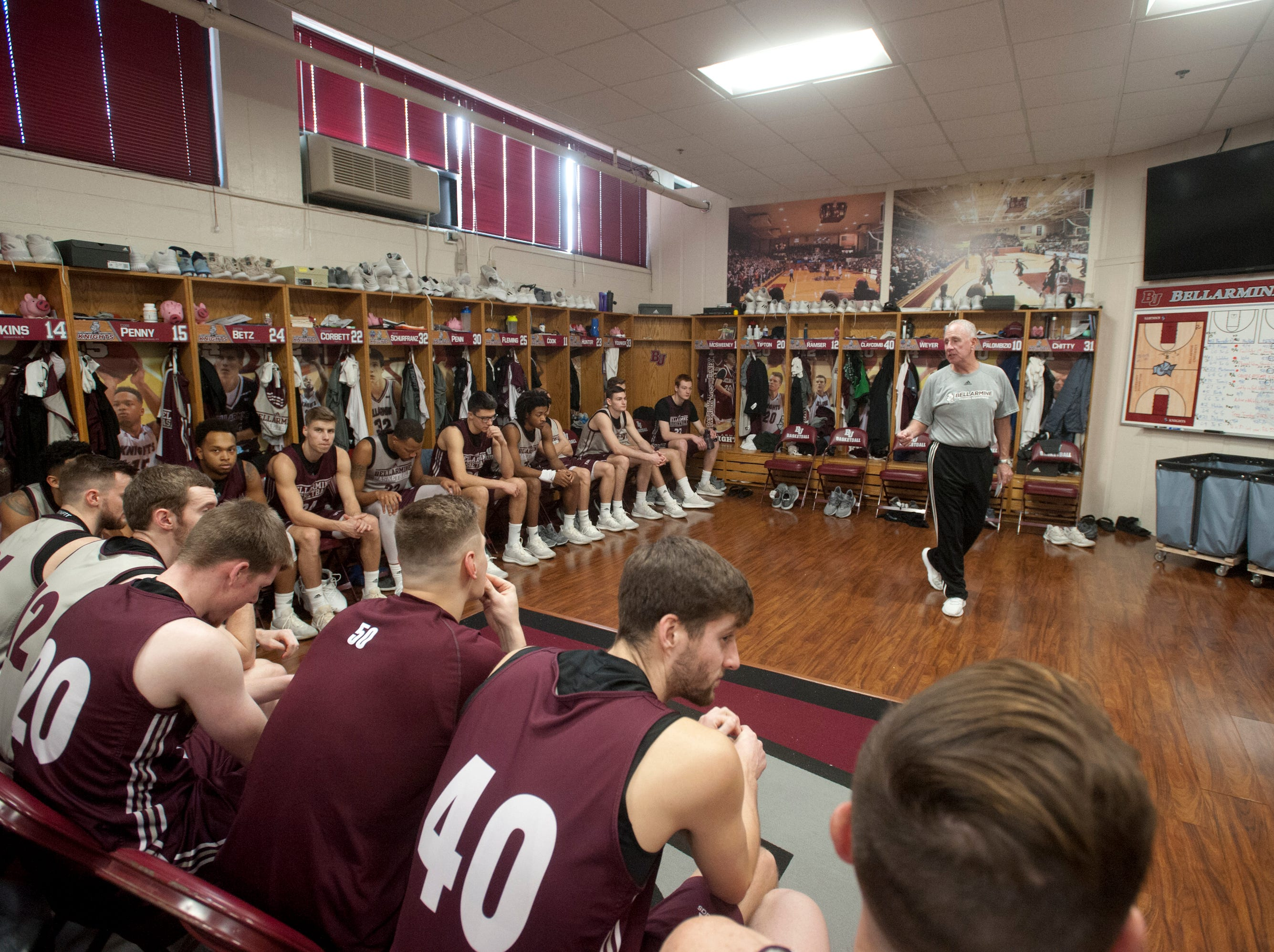 Bellarmine head basketball coach Scott Davenport takes over the after-practice meeting with the team in their locker room.18 December 2018