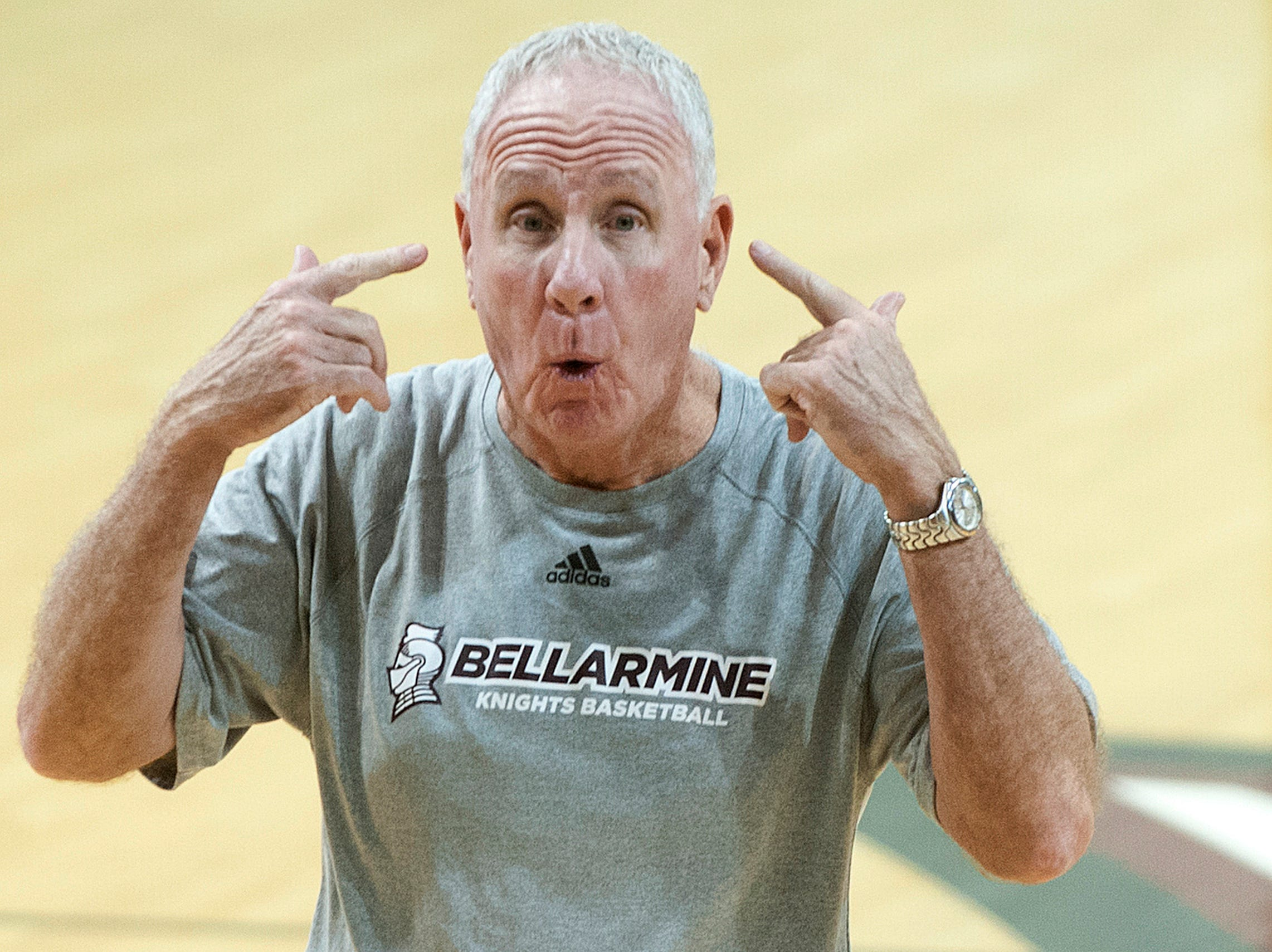 Bellarmine head basketball Coach Scott Davenport tells his players to think about their assignments during a practice drill in Knights Hall.18 December 2018