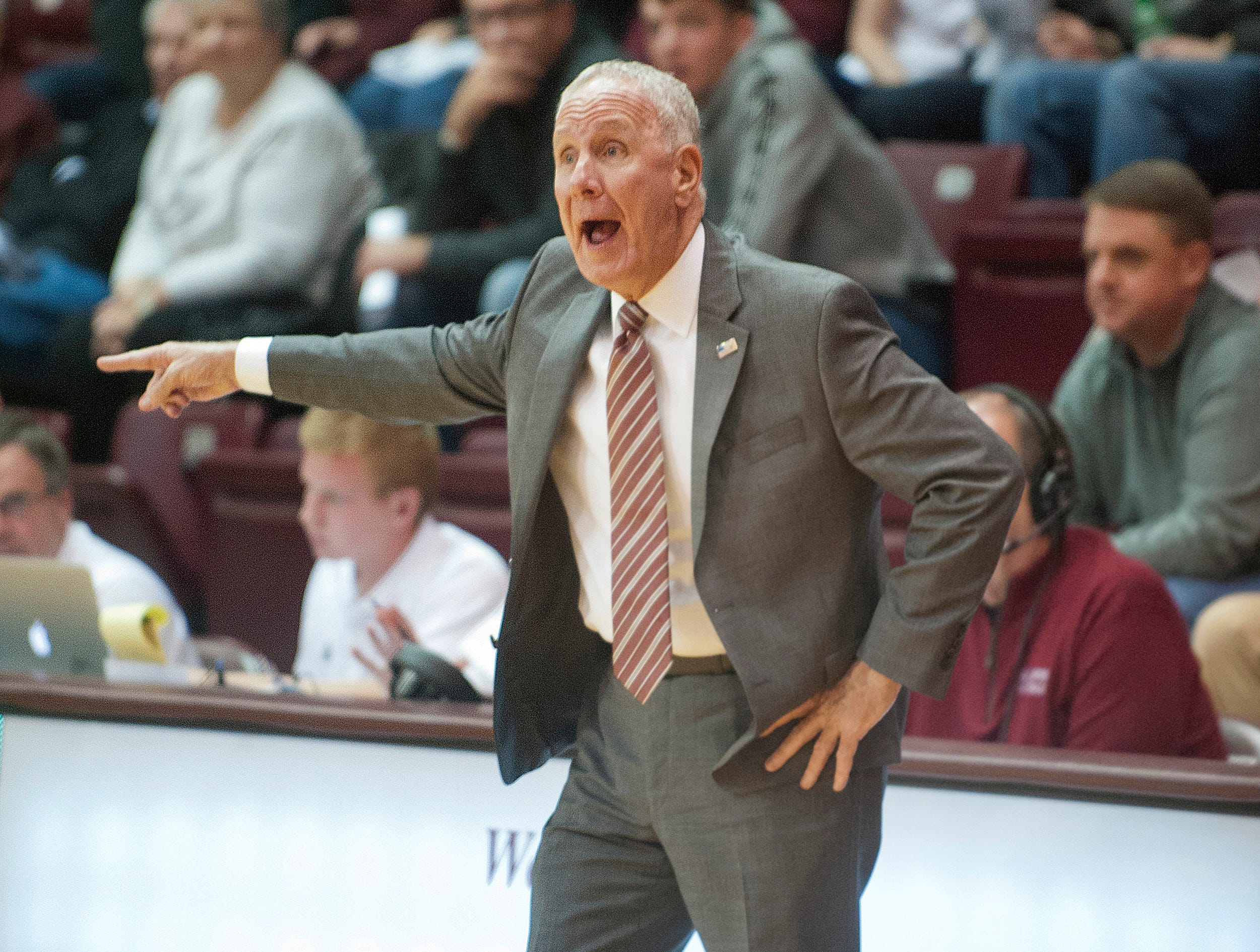 Bellarmine head basketball coach Scott Davenport yells instructions to his players on the floor during the game.18 December 2018
