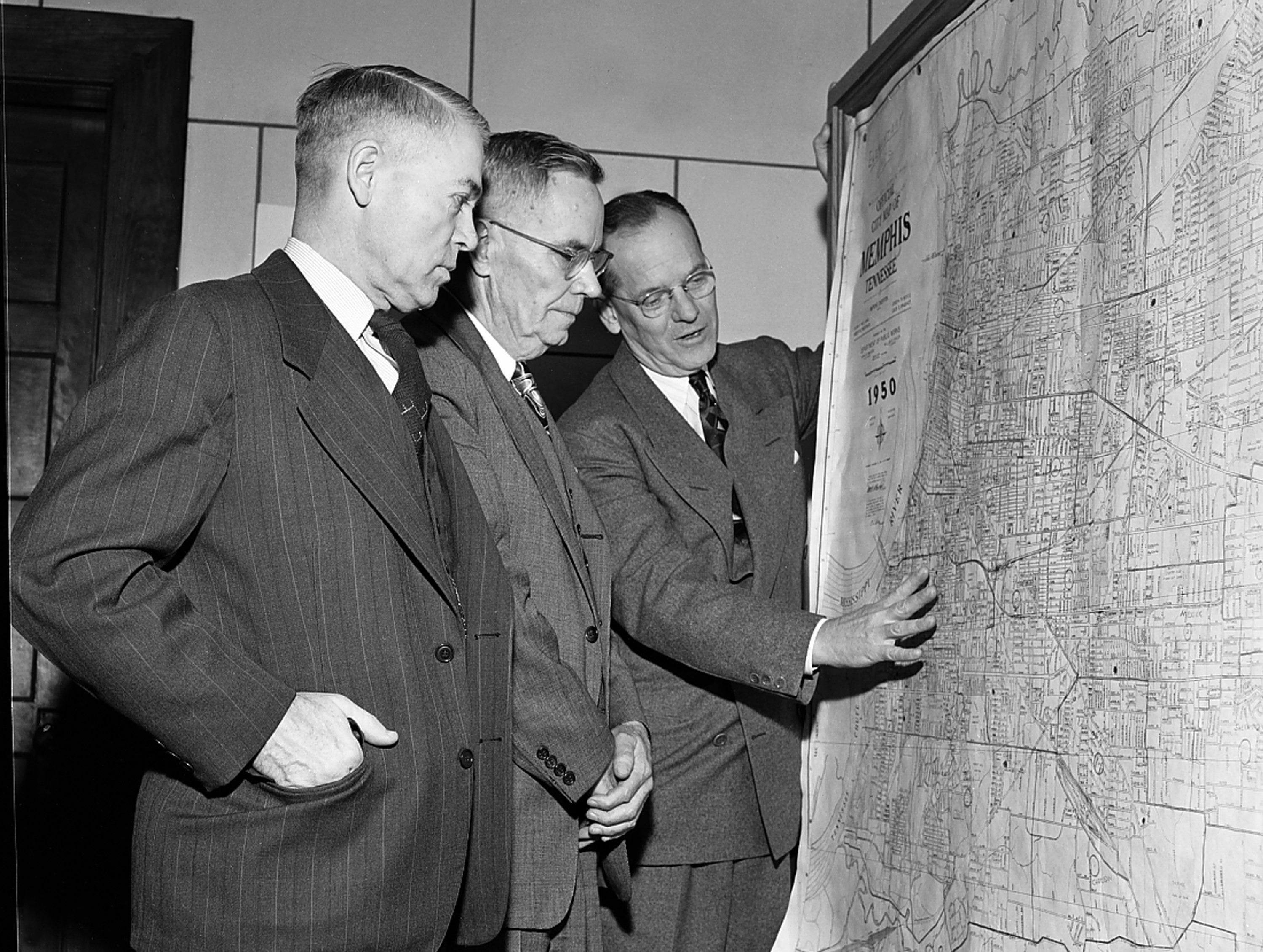 How Memphis schools have kept pace with the rapid growth of the city was pointed out in February 1951 to Lyman Fort (Left), superintendent of schools at Sioux Falls, S.D.  Mr. Fort talked school problems with O.H. Jones (Center), financial secretary of the Memphis Board of Education, and Ernest Ball, superintendent of city schools.  Mr. Fort was in town to address the Rotary Club.