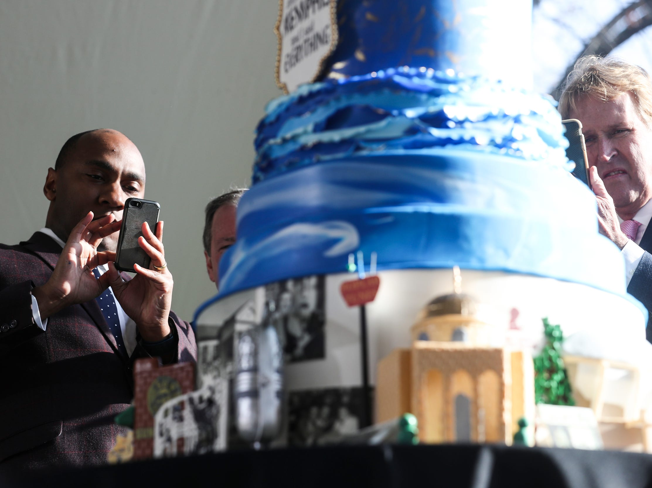 January 08 2019 - Shelby County Mayor Lee Harris, left, and Kevin Kane, president and CEO of the Memphis Convention & Visitors Bureau, take pictures of Elvis' birthday cake as fans and officials gathered on Graceland's north lawn on Tuesday to celebrate during the Elvis Birthday Proclamation Ceremony. Tuesday would have been Elvis' 84th birthday.