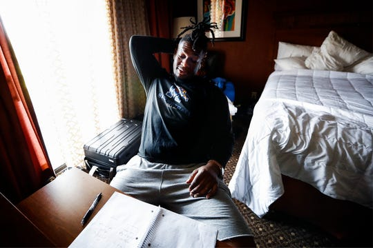 Former Tiger football player Latarius Brady studies a playbook in the team hotel while attending Memphis Express training camp in San Antonio, Texas. Brady, a 2016 graduate of Memphis, hopes to make the Express' 50-man roster and continue his football career.