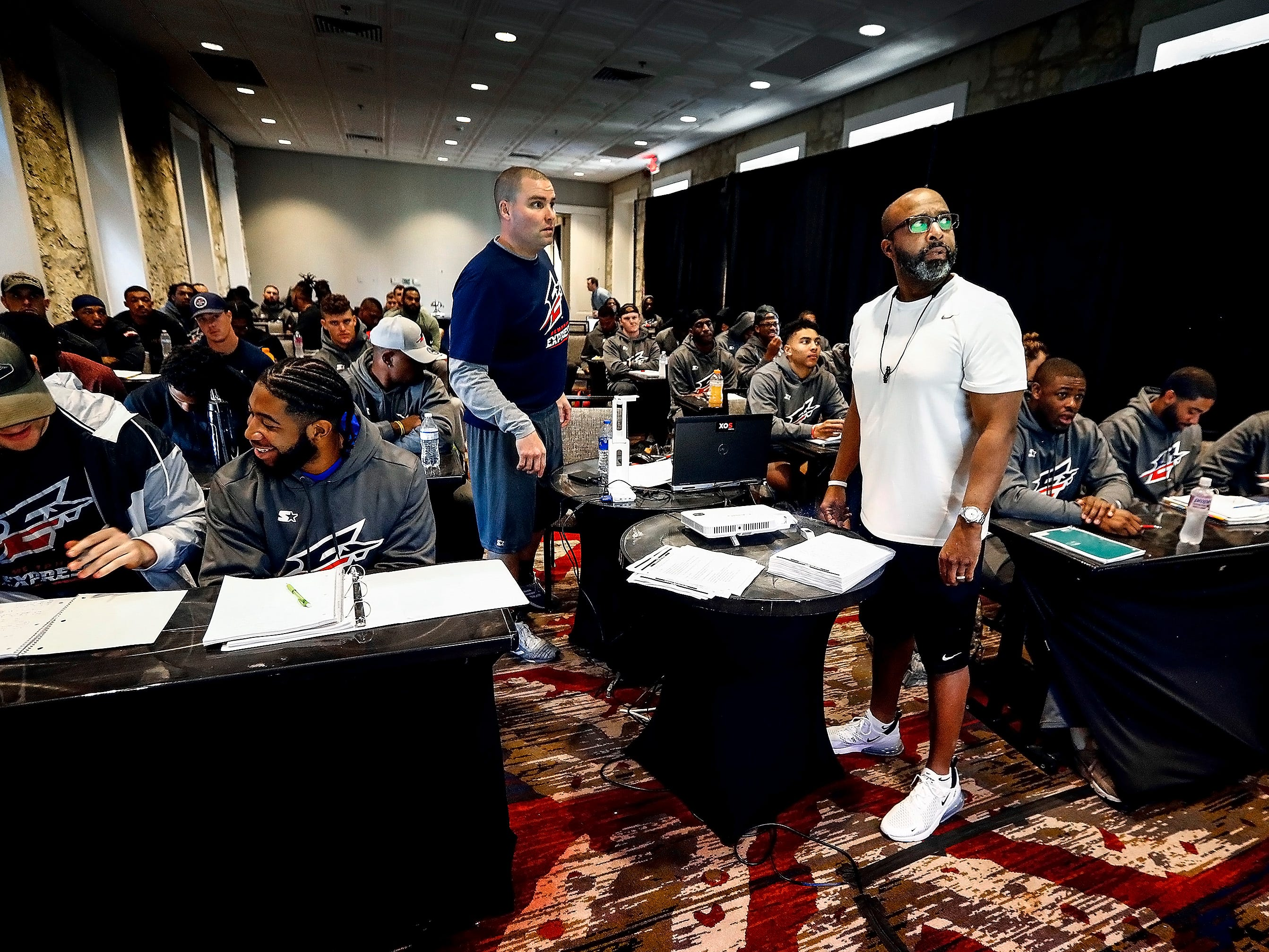 Memphis Express special teams coach Ty Knott (right) goes over schemes with the players during training camp in San Antonio, Texas.