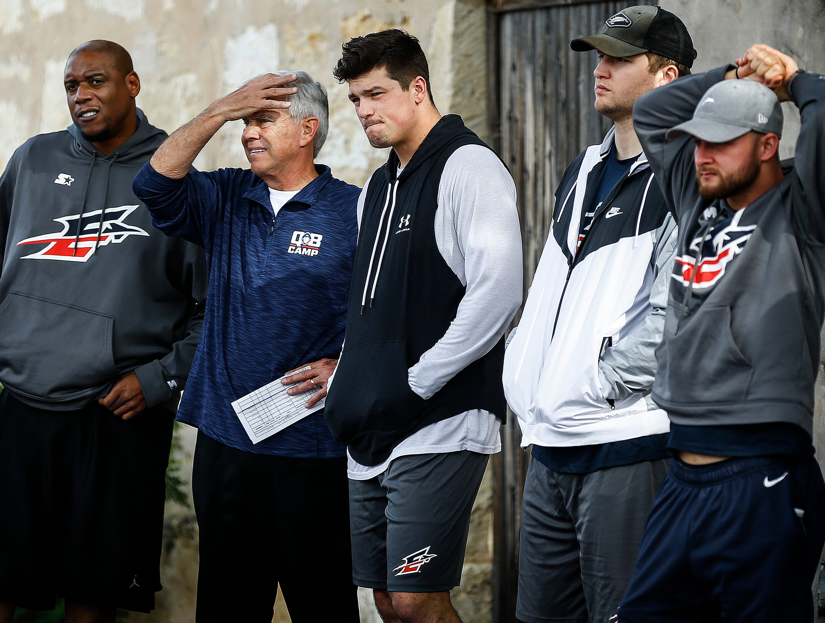 Memphis Express offensive coordinator David Lee (middle left) and quarterback Christian Hackenberg (middle right) watch a team walk-through during training camp in San Antonio, Texas.