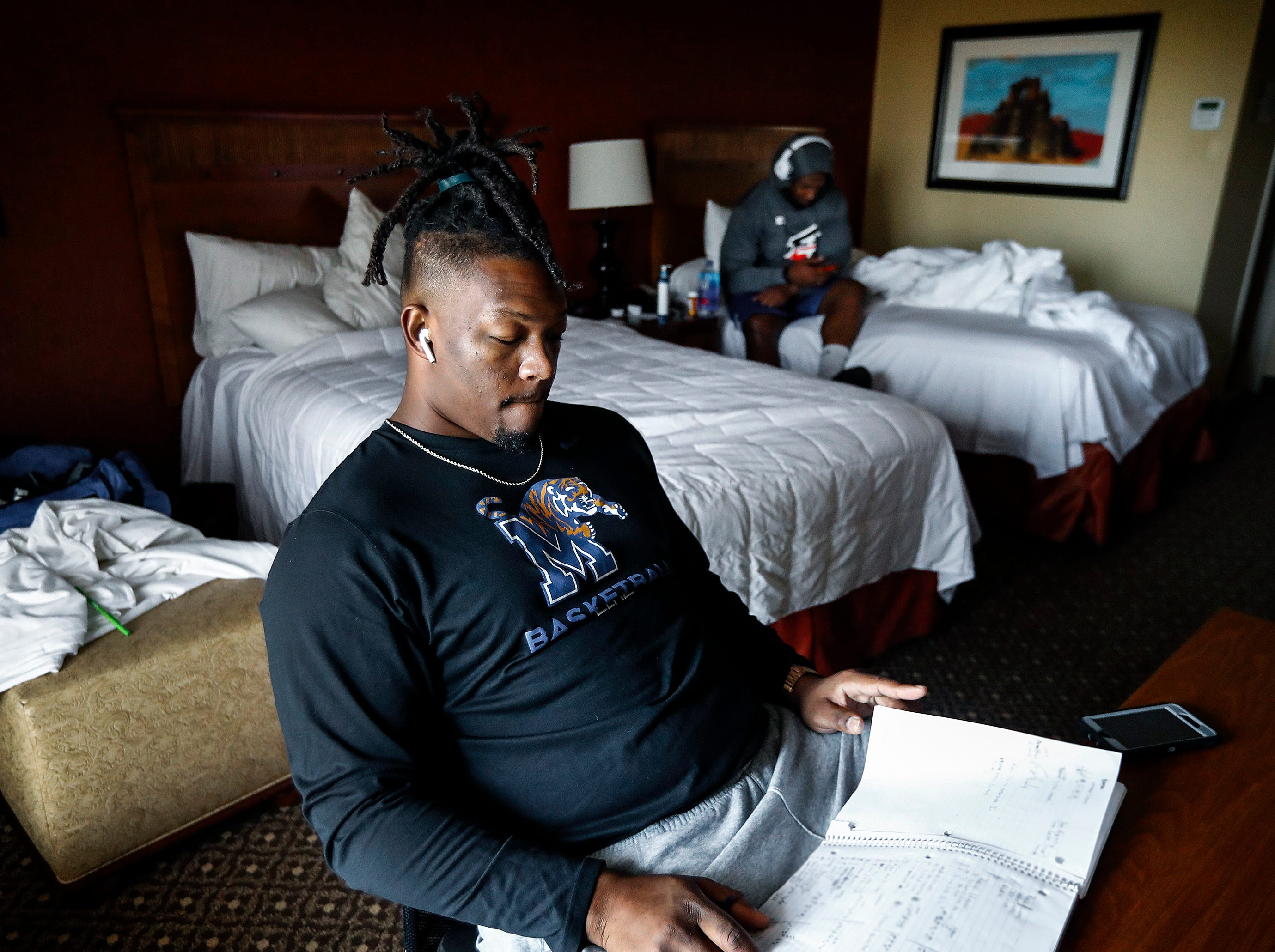 Former Tiger football player Latarius Brady studies a playbook in the team hotel while attending Memphis Express training camp in San Antonio, Texas. Brady, a 2016 graduate of UofM hopes to make the Express 55-man roster and continue his football career.