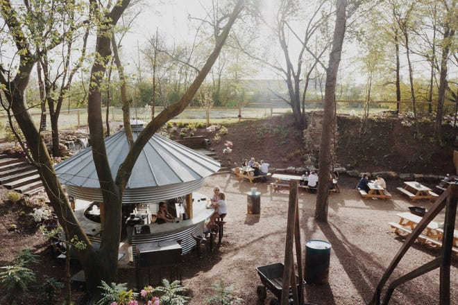 The back yard  at Carolina Watershed includes a bar, cascading waterfalls, cozy nooks and stage areas for live music. A covered patio is being added this winter.